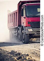 trucks operating in a coal mine at work