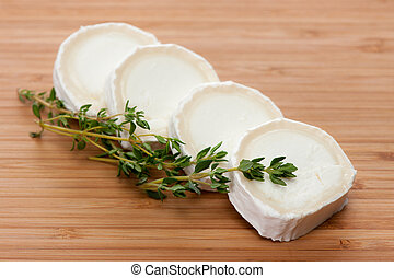 Slices of Goat cheese with thyme - Slices of Goat cheese...
