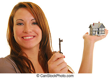 Attractive woman with skeleton key and miniature house -...