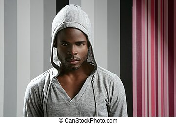 African american man with gray hood over wallpaper...