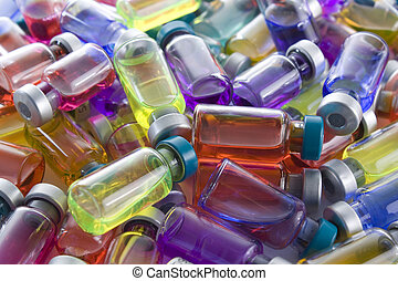 Vaccines - A collection of colorfull small bottles of...