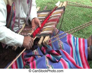 Weaving a rug in Peru - Man weaving a rug in Peru