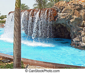 Luxury pool with waterfall - Luxury pool with palm trees and...