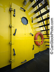 Life Buoy - A water-tight door and life buoy on a...