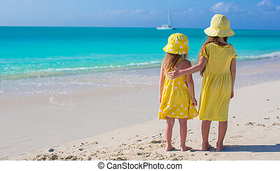 Two adorable little girls on caribbean vacation - Back view...