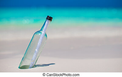 Bottle with a message buried in the white sand - Bottle with...