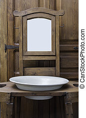 Old Washbasing and Mirror.
