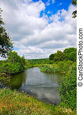 Summer landscape with low clouds and the river