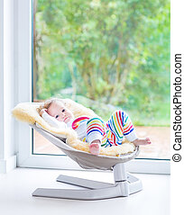 Cute little girl relaxing in swing - Cute little girl...
