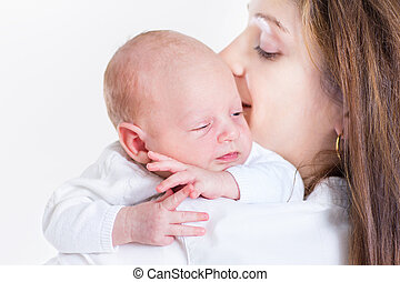 Cute funny newborn baby sleeping on his mother's shoulder