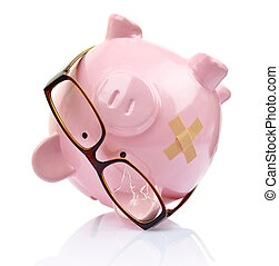Piggy bank with broken eyeglasses and bandage upside down