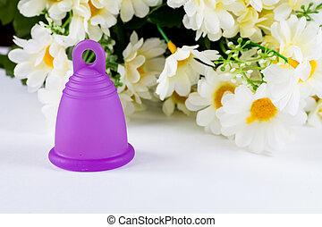 Menstrual cup and flowers - Studio shot of a bell-shaped...