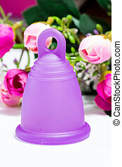 Menstrual cup and roses - Studio shot of a bell-shaped...