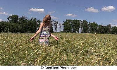 pregnant woman walk field - Pregnant woman walk between ripe...