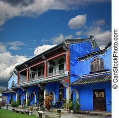 Chinese blue mansion under cloudy sky - View of the chinese...
