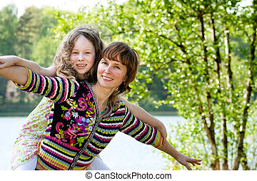 Let\'s fly - Mother and daughter have a happy time together