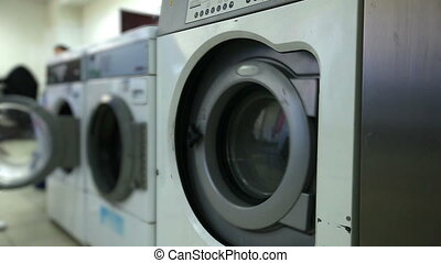 Washing machines in laundry room, close-up