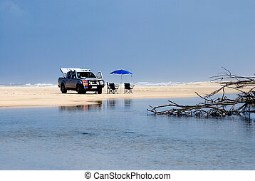 Beach scenery on Fraser Island with 4WD - Car with beach...
