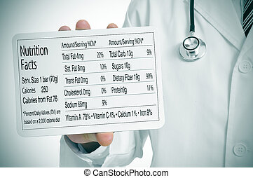 nutrition facts - a doctor showing a nutrition facts table