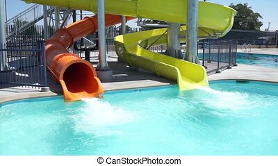 Swimming Pool Water Slides - The water slides at a public...