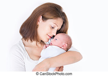 Beautiful young mother holding her sweet newborn baby
