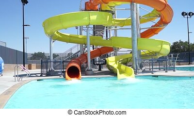 Swimming Pool Water Slide - A shot of the water slide at a...