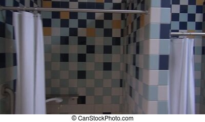 Pool Showers - Camera moves along the side of colorful tiled...