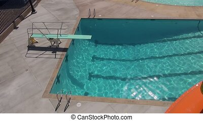 Diving Board Pool - Top view shot of the diving board at...