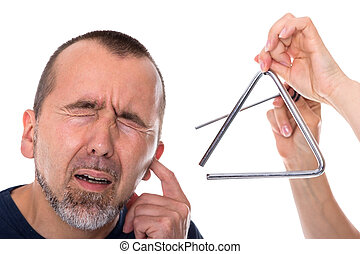 Tinnitus - A triangle next to the head of a man in agony