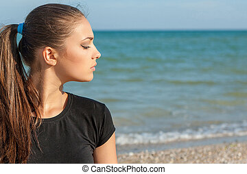 profile woman - profile Young woman on background of sea...