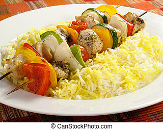 Chicken Kebabs and Rice - Seasoned chicken kebabs with bell...