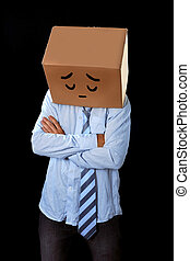 messy business man with carboard box on head sad expression...