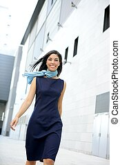 Beautiful stewardess walking to convention center -...