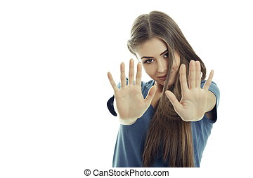 Woman making stop gesture - Beautiful young woman with long...