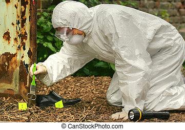 crime scene - criminologist investigates a crime scene...