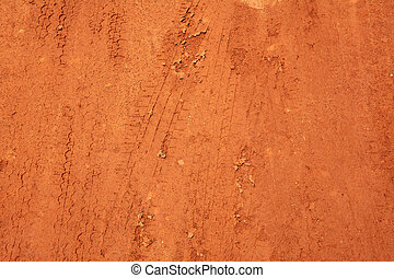 Wheel tracks on red soil rural road background