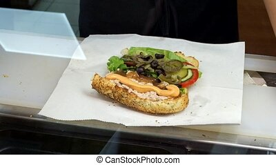 Delicious grilled cutlet sandwich plated with crunchy...