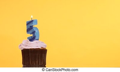 Birthday cupcake with candle number five. - Birthday cupcake...