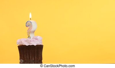 Birthday cupcake with candle question mark.