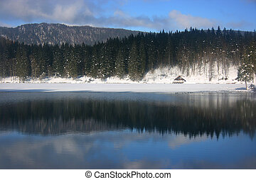 Fusine lower lake hut - View of lower lake and hut in...