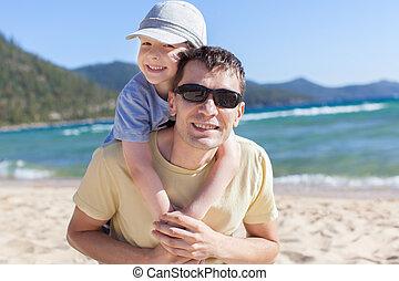 family at lake vacation - cheerful family of two having fun...