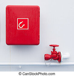 Firehose - Red handled firehose outlet and a box with a...