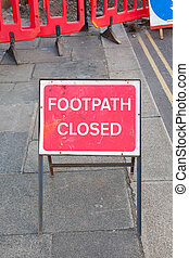 Footpath closed sign - Footpath closed by road maintenance...