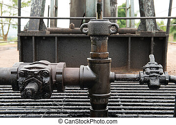 crude oil from oil well - pumpjack pumping crude oil from...