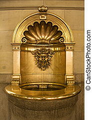 Baptismal font in gold in a church
