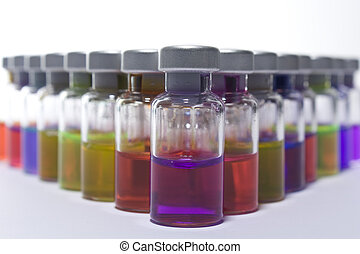 vaccine - A collection of colorfull small bottles of...