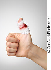 Injured finger with bloody bandage - Injured finger with...