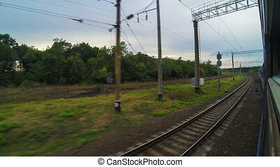 Traveling by passenger train timelapse. View from the train window.