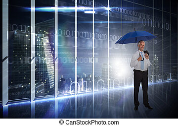 Composite image of happy businessman holding umbrella -...