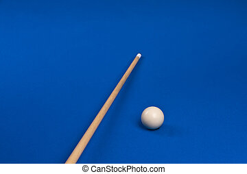 cue stick - cue tip on the pool table with white ball at a...
